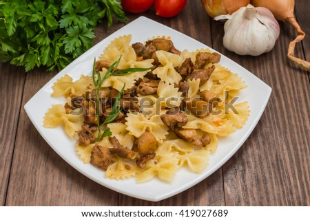 Farfalle with chicken and honey on a wooden table