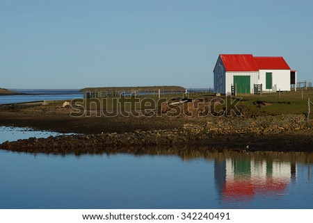 Farm building on the coast of Bleaker Island in the Falkland Islands - stock photo