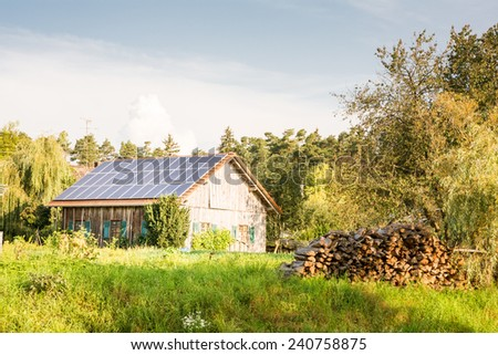 Farm building with innovative roof for alternative energy creation - stock photo