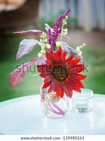 Farm casual arrangement of flowers - stock photo