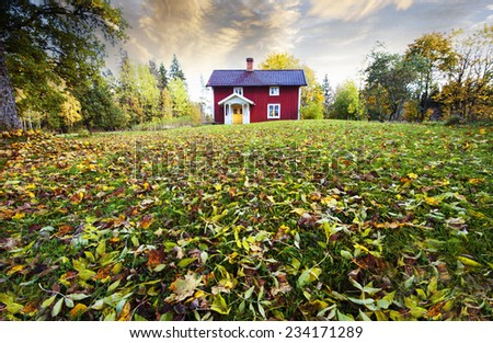 farm, cottage set in old rural landscape with autumn leaves - stock photo