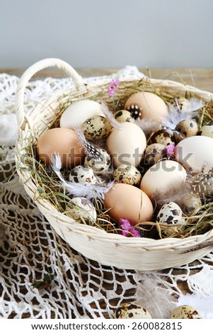 Farm Easter eggs in basket, easter - stock photo