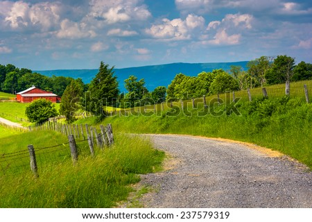Farm fields along a dirt road in the rural Potomac Highlands of West Virginia. - stock photo