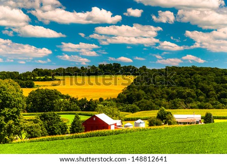 Farm fields and rolling hills in rural York County, Pennsylvania. - stock photo