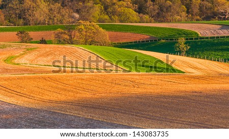 Farm fields and rolling hills of Southern York County, Pennsylvania. - stock photo