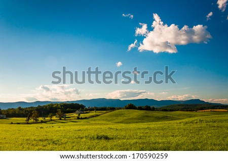 Farm fields and view of Massanutten Mountain, in the Shenandoah Valley, Virginia. - stock photo