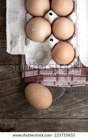 Farm Fresh Brown Chicken Hen Eggs on Rustic Wood  Background  - stock photo