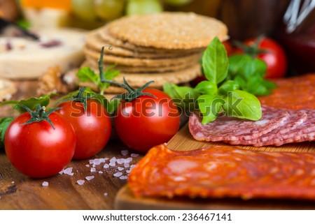 Farm fresh cherry tomatoes with basil - stock photo