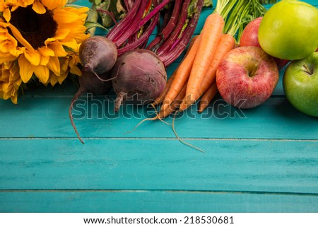 Farm fresh organic vegetables on rustic wooden blue table background - stock photo