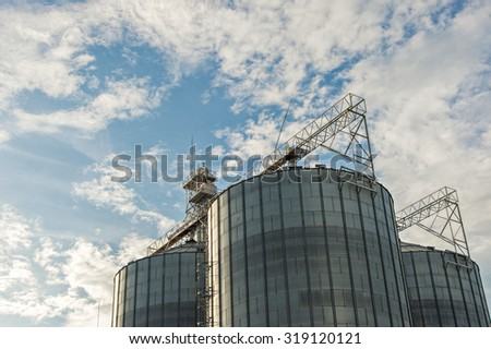 Farm grain silo agriculture industrial production - stock photo