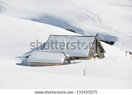 Farm house buried under snow, Melchsee-Frutt, Switzerland - stock photo