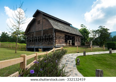 Farm house / fresh blue sky and green pasture - stock photo