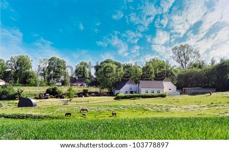 Farm house in Denmark, with horses and machines