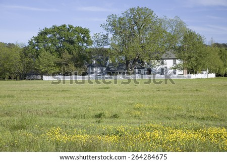 Farm house in green grass along Route 13 on the Eastern Shore of Maryland - stock photo
