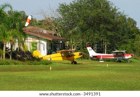 Farm house with private airplanes - stock photo