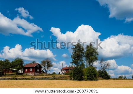 Farm in the country side of southern Sweden in the highlands of Smaland near Ingatorp - stock photo