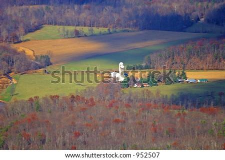 Farm in Valley - stock photo