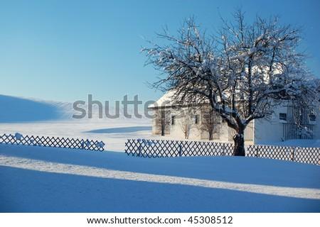 Farm in Winter Landscape - stock photo