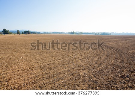 Farm land property in the country prepped and ready for a farmer or rancher to plant an agriculture crop. - stock photo