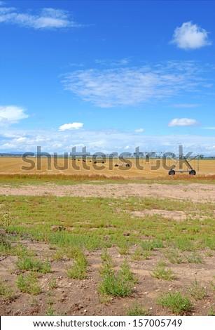 Farm land with Irrigation Equipment - stock photo