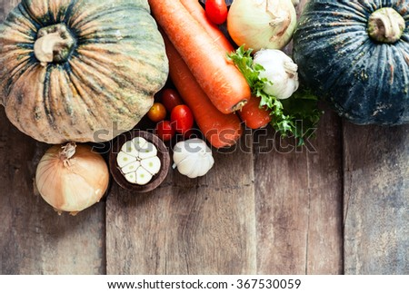 Farm market photo with different vegetables and greens - view from the top. Organic products and healthy lifestyle photography. Fresh food on the wooden background.