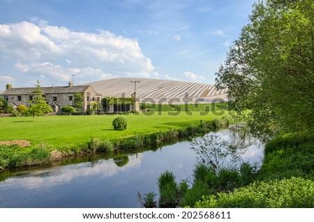 Farm near the river Bela - stock photo