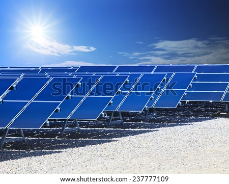 farm of solar cell panel and sun energy power shining on blue sky use for clean energy of innovation technology of future conception - stock photo