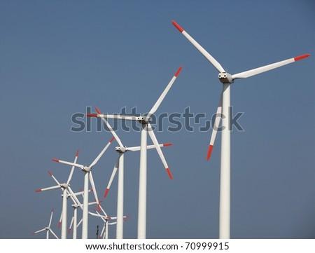 Farm of wind turbines; telephoto shot - stock photo