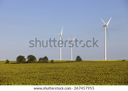 farm of windturbines in the north of France - stock photo