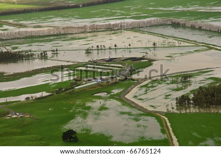 Farm paddocks partially underwater after massive flooding - stock photo