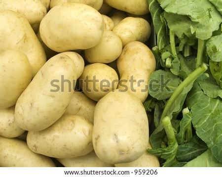 Farm Products - Potatoes & Greens - stock photo