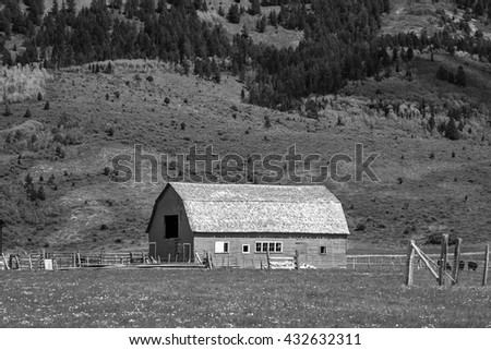 Farm scene with a barn in rural Wyoming, USA. - stock photo