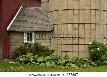 farm silo house with brick walls and shingled roof