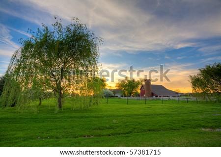 Farm sunset - stock photo