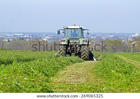 farm tractor at work - stock photo