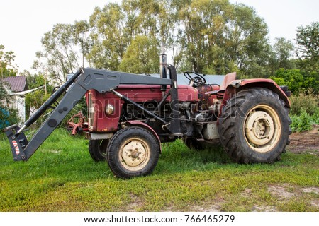 farm tractor, stands in the yard, old machine