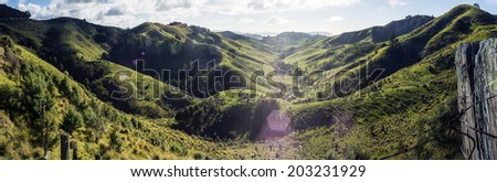 Farm Valley Panoramic / a large file panorama of a lush farm valley in New Zealand  - stock photo