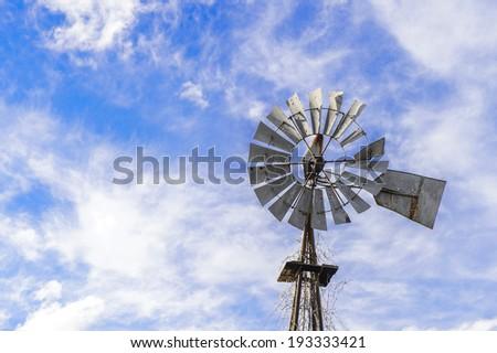 Farm Weather Vane Windmill - stock photo
