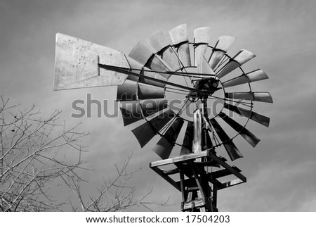 Farm windmill in black and white - stock photo