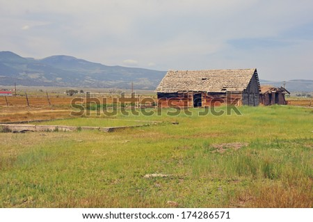 Farm with Barn in Rural landscape in the Western USA - stock photo