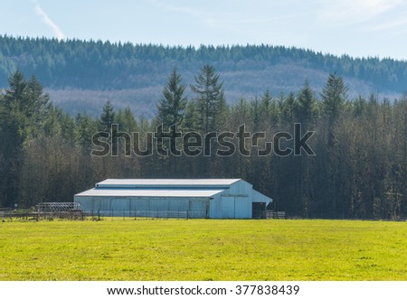 farm with  green field  in countryside on the day. - stock photo