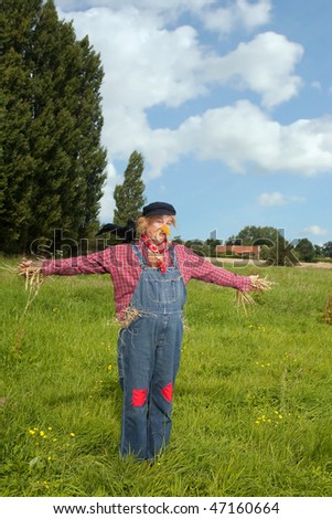 Farmer acting as a living scarecrow with a black crow on his shoulder - stock photo