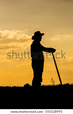 Farmer and sunset - stock photo