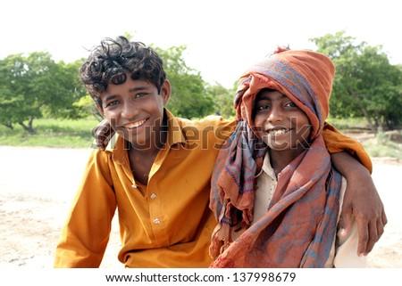 Farmer brothers looking at camera - stock photo