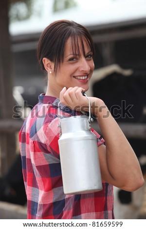 Farmer carrying milk - stock photo