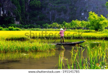 Farmer carrying paddy go home on a small boat