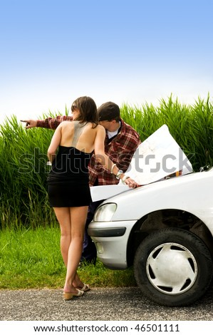 Farmer giving directions to a beautiful woman, lost in the country side - stock photo