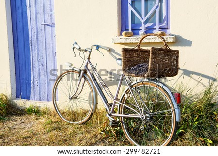 Farmer house and bicycle near lavender fields near Valensole in Provence, France. With bike, lavender bouquet in basket with typical provencal style. - stock photo