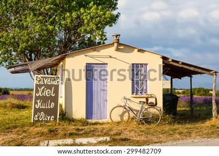 Farmer house near lavender fields near Valensole in Provence, France. With bike, lavender and for selling of honey and lavender. - stock photo