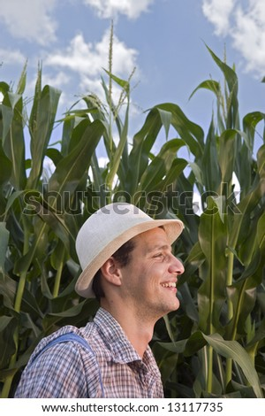 farmer in front of a corn field - stock photo
